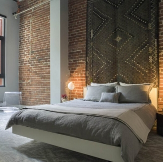 Custom bedding and shams fabricated by Stitch contribute to the Zen-like feel of this loft interior designed by Jennifer Gustafson. Photographed by David Duncan Livingston.