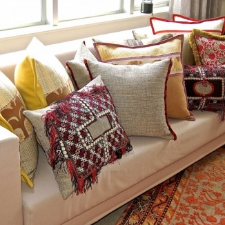 Stitch fabricated numerous intricately designed pillows from antique fabrics and contemporary linens that incorporate a variety of trim and flange treatments for interior designer Jennifer Mobley of Mobley Bloomfield.