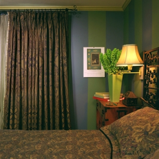 A heavily lined but subtle wool paisley over sheers on French doors keep this garden-facing Noe Valley master bedroom warm on chilly nights.