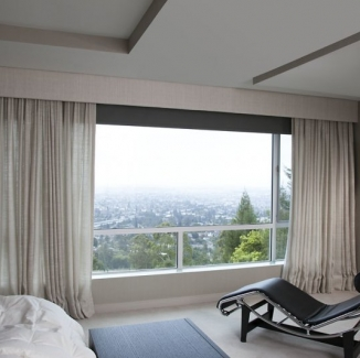 Stitch upholstered a simple cornice with the same Jim Thompson raw silk fabric of the draperies to conceal a large motorized black-out shade for this Berkeley Hills bedroom.