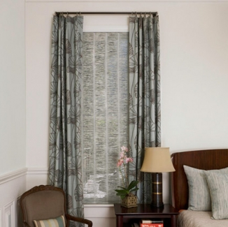 The Romo linen of the drapery is paired with the muted tones of a Conrad shade to establish a sense of calm and add sophisticated interest in this master bedroom. The small diameter rod and rings do not overpower the curtains and the texture of the shade.