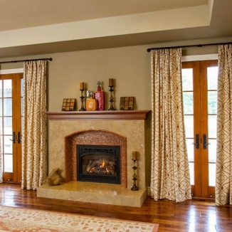The embroidered fabric was selected especially to compliment and bring out the intricate tile work in the adjoining fireplace.