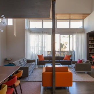 Afternoon glare was an issue for the upper loft office in this contemporary San Francisco home. Stitch made up clean modern draperies that help cut glare and filter light yet don't compete in this clean crisp interior.