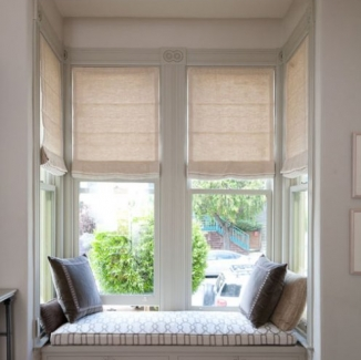 Programmable motors control these Roman shades so they come down automatically in the heat of the afternoon to keep things cool in this west facing San Francisco bay window.