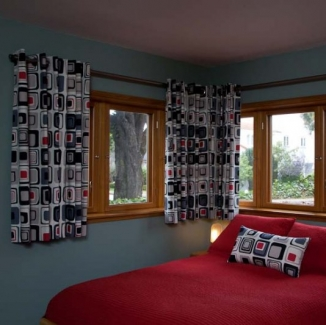 Grommeted curtains for these corner windows reflect the style of this San Francisco boys' bedroom.