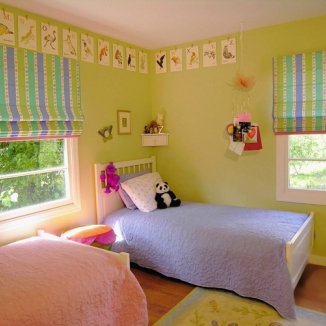 A fun cotton print used in these Roman shades pulls together all the colors in this Lafayette, California girl's bedroom.