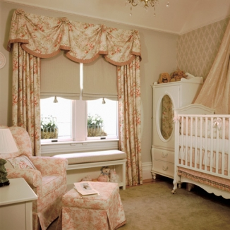 Stitch designed this San Francisco nursery in a formal French style. The window treatment features an embellished swagged valence, curtains, and soft Roman shades that coordinate with the wallpaper and other furnishings.