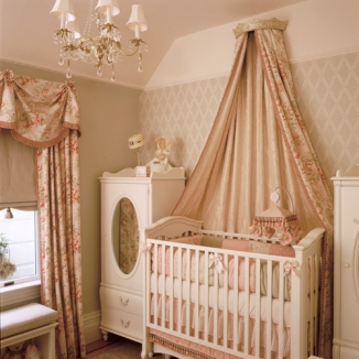 Laura Ashley fabrics are also used in this elaborate bed treatment that hangs from a wall-mounted corona.