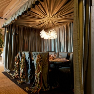 Stitch and Kathleen Monroe Design created this watery world for Dining by Design 2011. Work included custom slipcovers outfitted with fabric-seaweed under a full on custom fabric tent for dining. The white coral chandelier and beautifully set table stand out against the muted watery fabric tones.