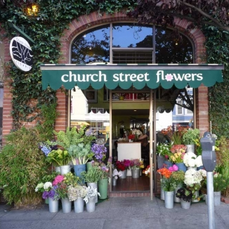 Stitch designed and installed this retractable awning for a local San Francisco flower shop.