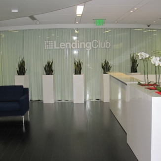 A 24' curved glass wall that separates Lending Club's lobby from its boardroom has sleek double-faced draperies hung from a motorized continuous curve track mounted on the ceiling.