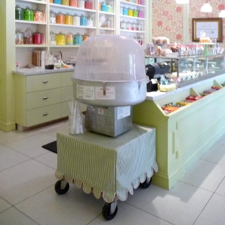 A custom cart skirt for a cotton candy machine with pink welt that's the color of cotton candy in this San Francisco Hayes Valley shop.