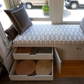 Charming window seating that functions as extra storage.