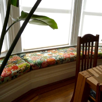 These fun breakfast room seat cushions bring the outdoors inside with a floral print.