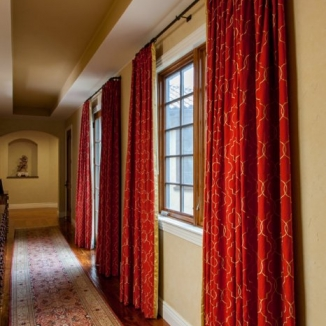 The embroidered fabric used in this hallway coordinates with the other fabrics in the master bedroom at the end of the corridor.