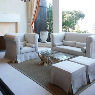 Indoor transitions to outdoor beautifully with custom fitted and easy-to-clean slipcovers in a neutral Perennials indoor/outdoor fabric.