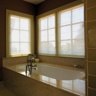 Motorized woven shades operate at a moment's notice if the owners want privacy in this Danville master bath.
