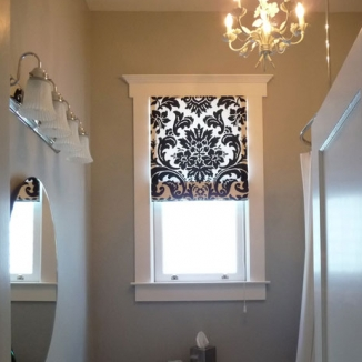 This graphic Roman shade adds a modern touch in this small Victorian bathroom in San Francisco's Noe Valley.