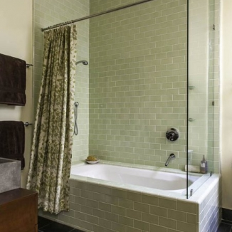 A green and cream large-scale botanical compliments the tile and slats in this contemporary San Francisco bathroom.