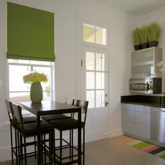 These crisp lime green Roman shades are constructed to reduce heat and cut sun exposure which is key for an upper floor unit on a sunny day.