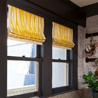 Roman shades use grosgrain banding to frame a Christopher fabric in this 2012 San Francisco Showcase kitchen by Green Couch.