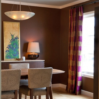 Silk drapes in a beautiful Gaston Y Daniela silk provide the dramatic final touch in this striking San Francisco Sunset neighborhood dining room. The richness of the deep bronze finish of the rod and contrasting rings compliment the deep colors of the wall.