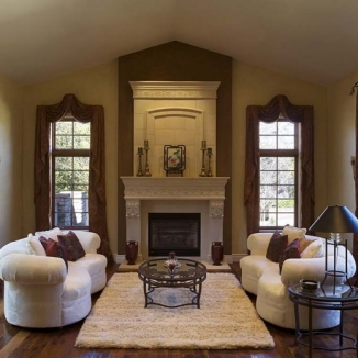 These carefully designed valances and draperies reflect the shape and tones of the tall fireplace surround to balance the proportion of the wall as well as emphasize the elegant formality of this lovely Hillsborough living room.