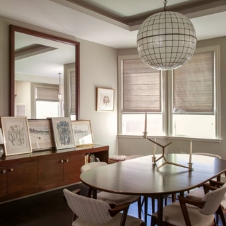 Stitch sourced the perfect grey raw silk from Jim Thompson for Roman shades throughout the common areas of this Nob Hill home. The daylight emphasizes the fabric's subtle textures and tones and works perfectly with the refined lines of the mid-century furnishings.