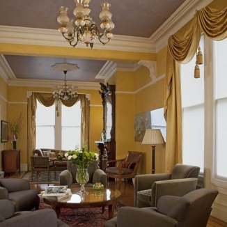 Stitch made up perfectly draped satin swags and tail window treatments for several windows to complete the décor of this elegant and formal Grand Victorian double parlor.